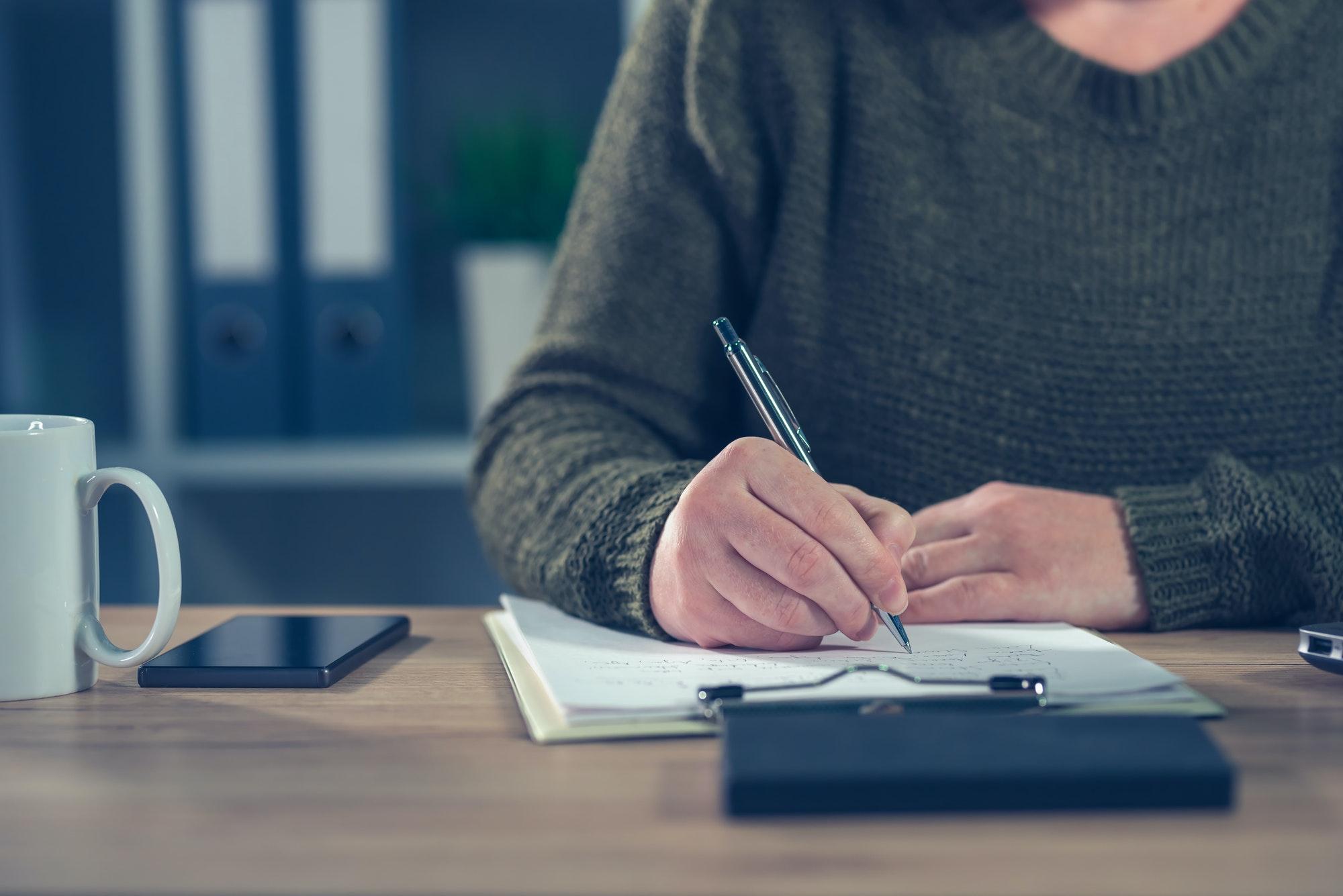 Female freelancer doing paperwork